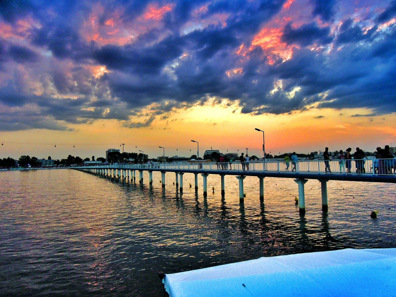 sunset, sky, water, reflection, cloud - sky, architecture, built structure, river, no people, nature, waterfront, building exterior, outdoors, beauty in nature, scenics, city, day