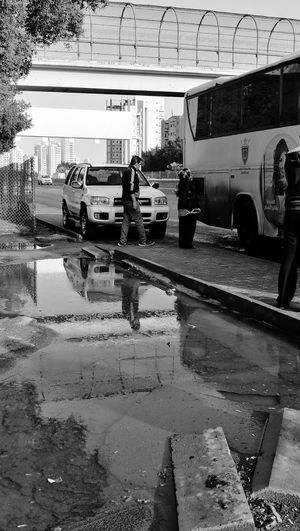 My Year My View monochrome photography After The Rain Reflections In The Water Land Vehicle Outdoors Waiting For A Bus Street Group Of People Transportation Urban Photography Sreet Photography Beauty In Nature Daytime Photography Lifestyles