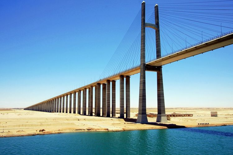 Low Angle View Of Suez Canal Bridge Against Blue Sky