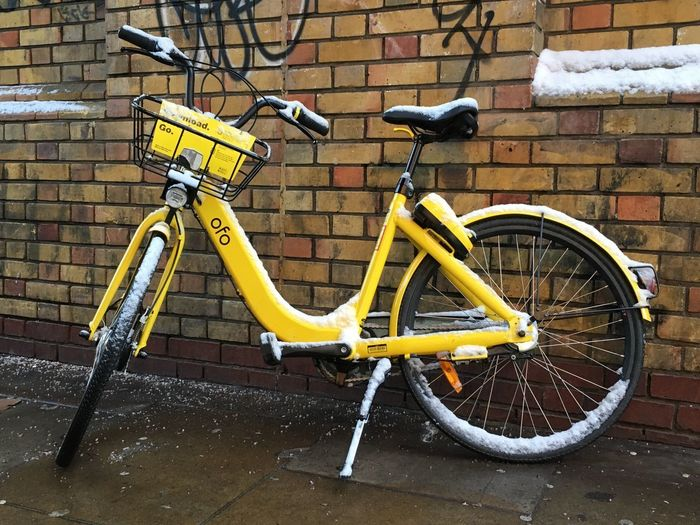 Snow Brick Wall Transportation Bicycle Mode Of Transport Stationary Yellow Outdoors Day No People Land Vehicle Built Structure Building Exterior Architecture Tire