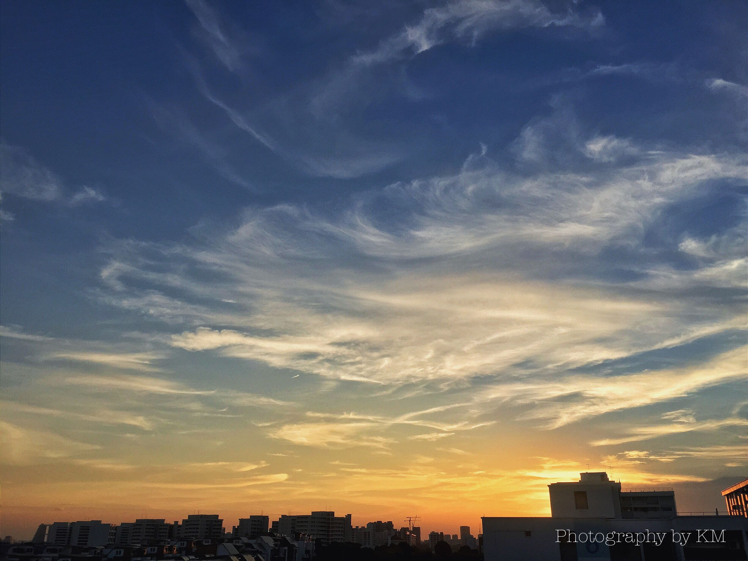 building exterior, architecture, built structure, sunset, city, sky, cityscape, cloud - sky, residential building, silhouette, residential district, residential structure, orange color, cloud, dusk, building, city life, outdoors, no people, scenics