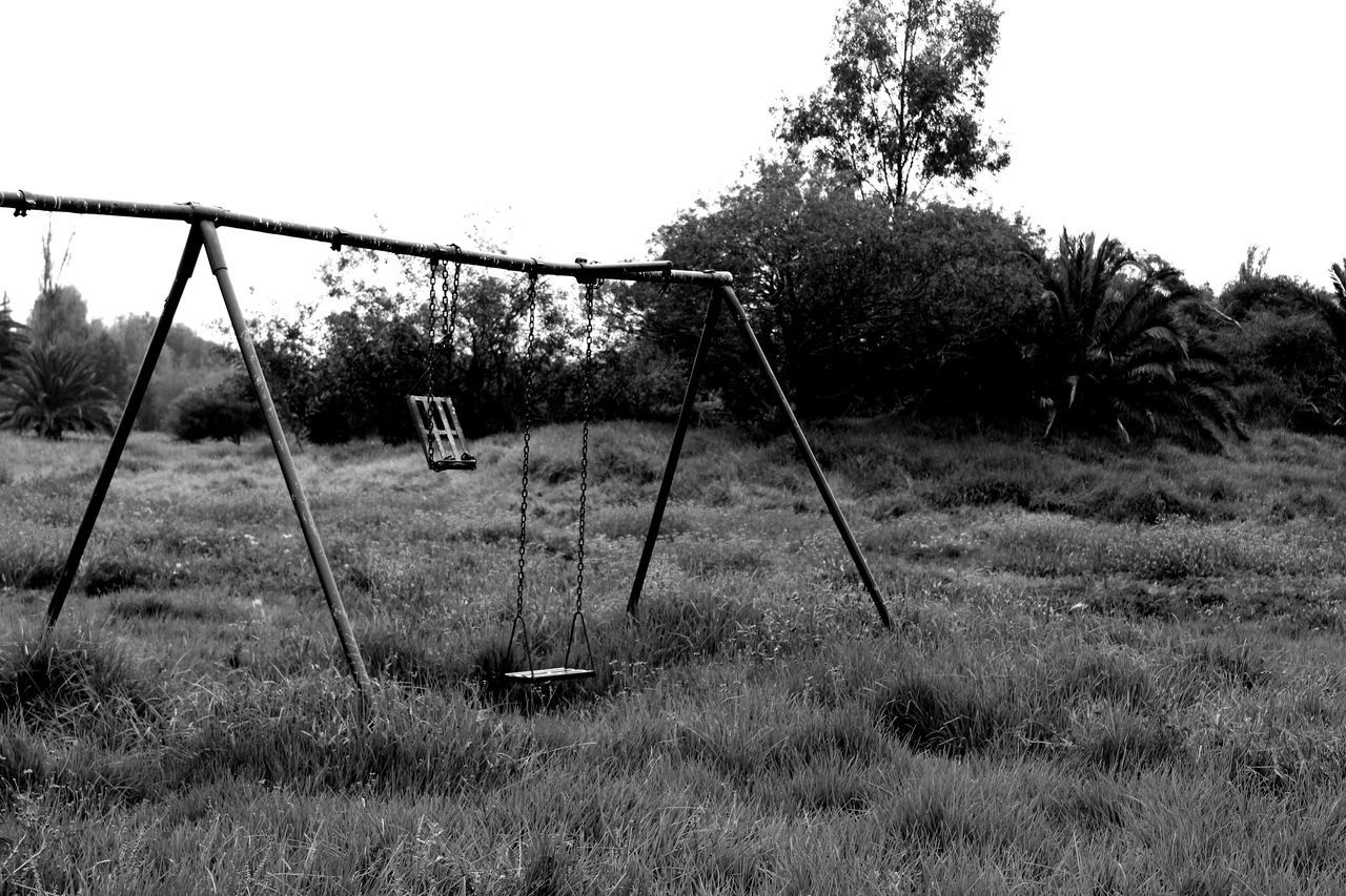 plant, grass, nature, tree, playground, field, day, no people, land, swing, absence, sky, growth, empty, outdoors, metal, tranquility, clear sky, abandoned, outdoor play equipment