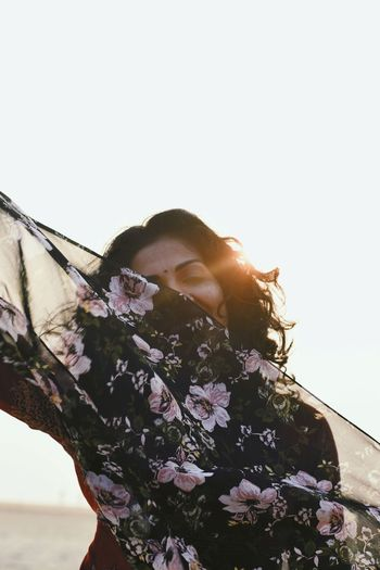 Portrait of woman with scarf against clear sky