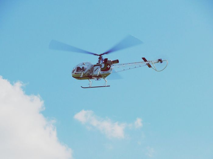 Low Angle View Sky Transportation Mode Of Transport Day Outdoors Helicopter Rescue Flying Blue Cloud - Sky Air Vehicle No People Nature Modellhelicopter