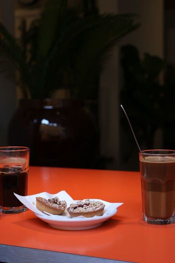 Close-up of drinks with dessert on table