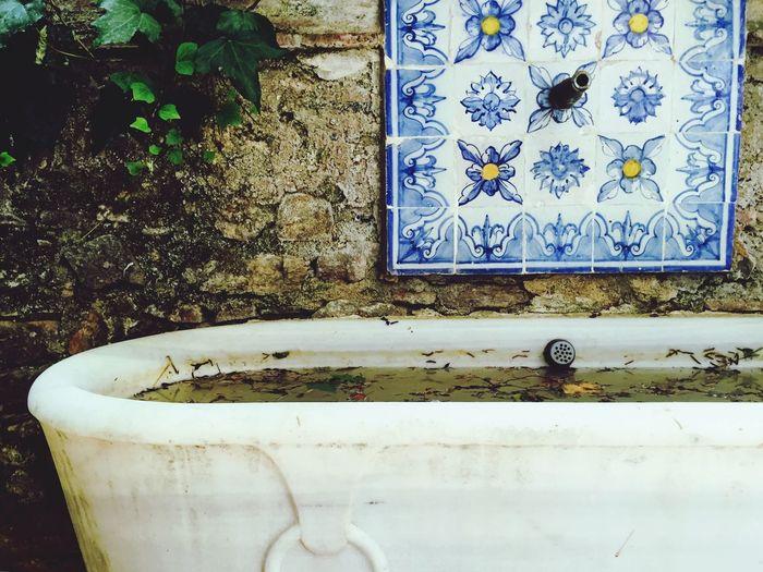 Close-Up Of Bath Tub Against Wall