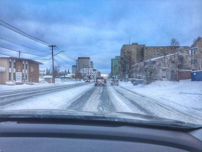 Driving through Yellowknife Car Transportation Land Vehicle Mode Of Transport Vehicle Interior Architecture Winter Weather Road Cold Temperature Snow Car Point Of View Windshield Building Exterior Built Structure Car Interior The Way Forward Sky Cloud - Sky Day
