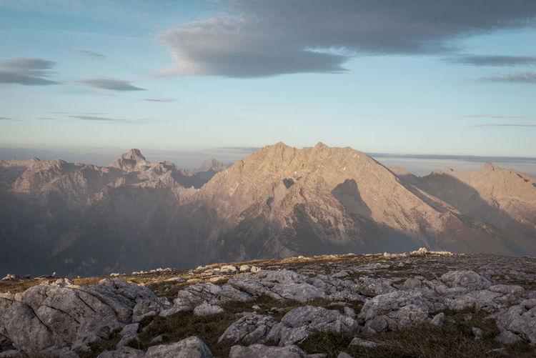 Idyllic shot of rocky mountains against sky during sunrise
