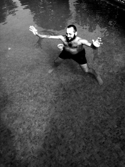 High angle portrait of man swimming in water