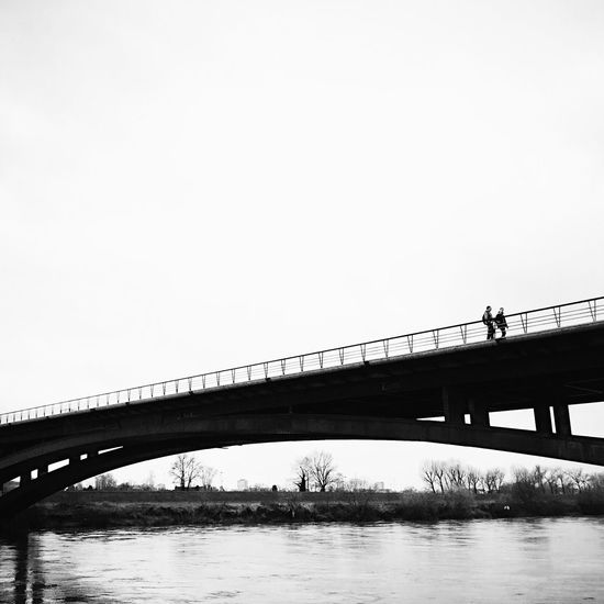 Liberty Bridge in Zagreb, Croatia, 2016. Zagreb Croatia Liberty Bridge Bridge Minimal Minimalism People Walking Simplicity Architecture Bridge - Man Made Structure Engineering Low Angle View Small River Clear Sky Black & White Serenity Relaxation