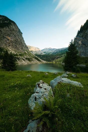 Lake Krn at sunset Beauty In Nature Exposure Grass Green Color Hiking Idyllic Lake Landscape Long Mountain Mountain Range Nature No People Non-urban Scene Outdoors Plant Remote Rock Scenics Sky Slovenia Sunset Tranquil Scene Walking Water