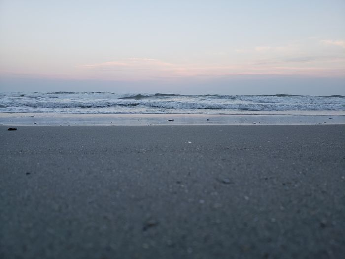 Evening Waves Ocean Waves Ocean Life Ocean Photography Ocean Tide Pink Grey Sand Seashell Evening Myrtle Beach SC Sea Sunset Beach Swimming Water Blue Outdoor Pursuit Idyllic Sky Horizon Over Water Low Tide Shore Sandy Beach Moody Sky