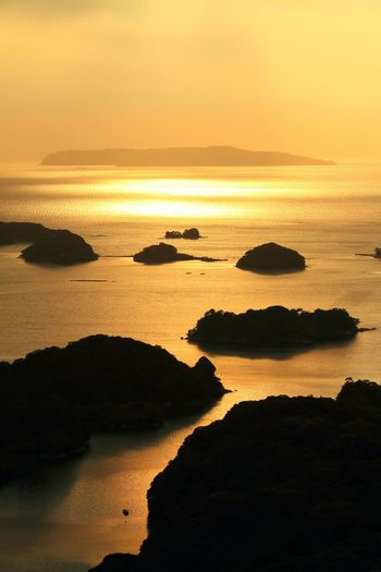 Silhouette Archipelagos In Sea Against Sky During Sunset
