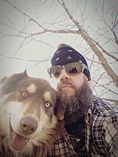 Selfie with man best friend. Dog Pets Domestic Animals Sunglasses Friendship One Animal Mature Adult Animal Themes Adult Looking At Camera Portrait Only Men One Man Only One Person Winter Happiness Beard Warm Clothing Day Adults Only Eyes Outdoor Mans Best Friend Husky Twocoloreyes Pet Portraits