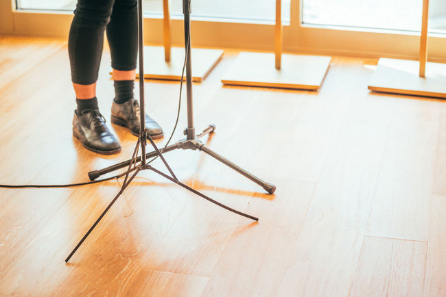 Music stands and mic cable at the feet of a performing musician Acoustic Mic Stand Music Close-up Concert Day Entertainment Feet Hardwood Floor Indoors  Legs Legs Music Low Section Musical Instrument Musician Musician Blog Musicians One Person People Real People Small Conert Tripod Tripod Legs Tripod Stands Tripods