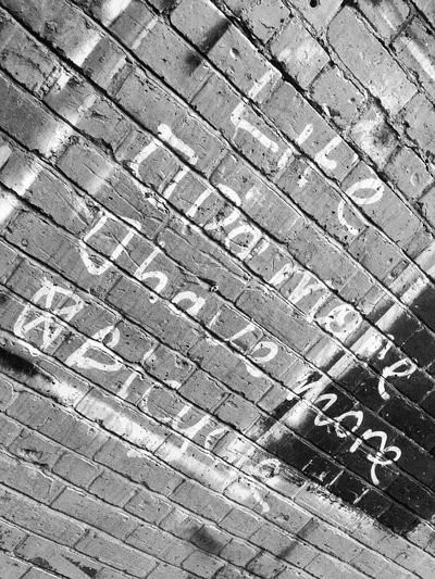 Wall quote Full Frame Day Backgrounds Outdoors No People Street High Angle View Pattern Textured  Close-up Graffiti Art Graffiti Wall Graffiti Manchester Manchester UK Urbanphotography Inspirational Bicycle Blackandwhite EyeEm Gallery June Showcase Quotes Quoteoftheday Brick Wall Art Is Everywhere