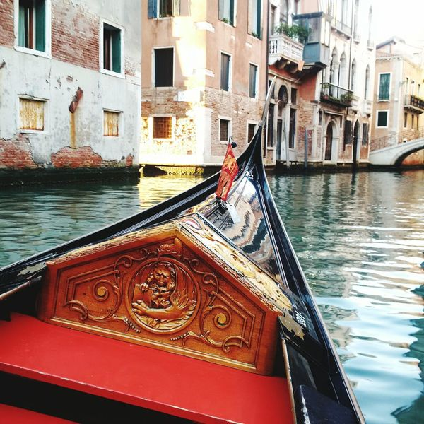 Cultures Canal Gondola - Traditional Boat Building Exterior Transportation Water Nautical Vessel Architecture Travel Destinations City Gondolier No People Outdoors Day Gondola Gondola Ride EyeEmNewHere Venice Canals Venice, Italy Wooden Boat Wood Lion Saint Mark's  Beauty Flag