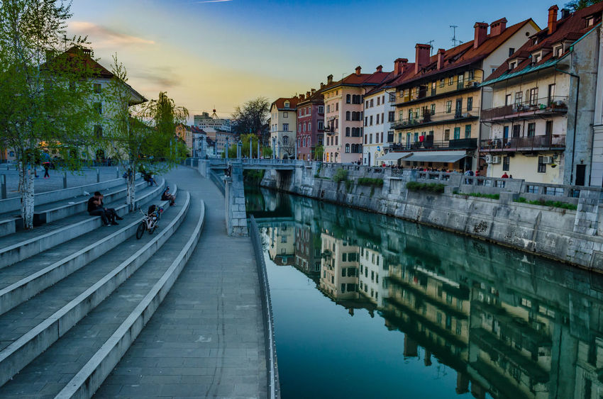 From Ljubljana with love - Captured this sunset hour shot in the centre of the Slovenian capital on a beautiful summer day. Slovenia is a beautiful unexplored country with diverse geography and landscapes. a must visit for any traveller. AravindNarayanan Ljubljana Ljubljana, Slovenia Ljubljanica Mirror Nikon Reflection Slovenia Travel Travel Photography Anpaphotography Architecture City Dusk Dusk In The City Golden Hour Nikonphotography Outdoors Summer Sunset Tourism Tourist Destination Travel Destinations Water Waterfront