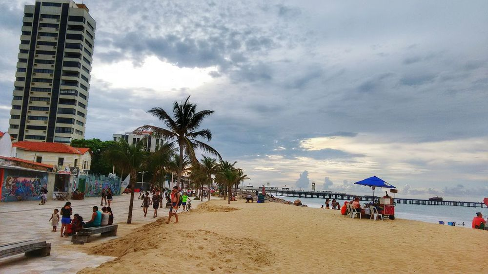 Beach Palm Tree Large Group Of People Travel Destinations Cloud - Sky Architecture Vacations Building Exterior Outdoors Sea Volleyball - Sport People Sand Sky Tree Water Adult Day Adults Only