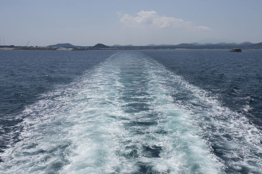 On board to Udo Island in Jeju Island, South Korea JEJU ISLAND  Beauty In Nature Day Motion Nature No People On Board On Boat Outdoors Rippled Scenics Sea Sky Tranquil Scene Tranquility Udo Voyage Wake Water Waterfront Wave