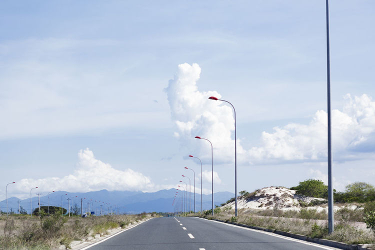 Red Road Alone Blue Sky Blue Sky And Clouds Bright Cloud - Sky Clouds Empty Road Eye4photography  EyeEm Best Shots EyeEm Gallery EyeEm Nature Lover Lamp Light Marker Nature No People Red Light Road Space Streetlights Streetphotography The Way Forward Transportation Travel Travel Photography