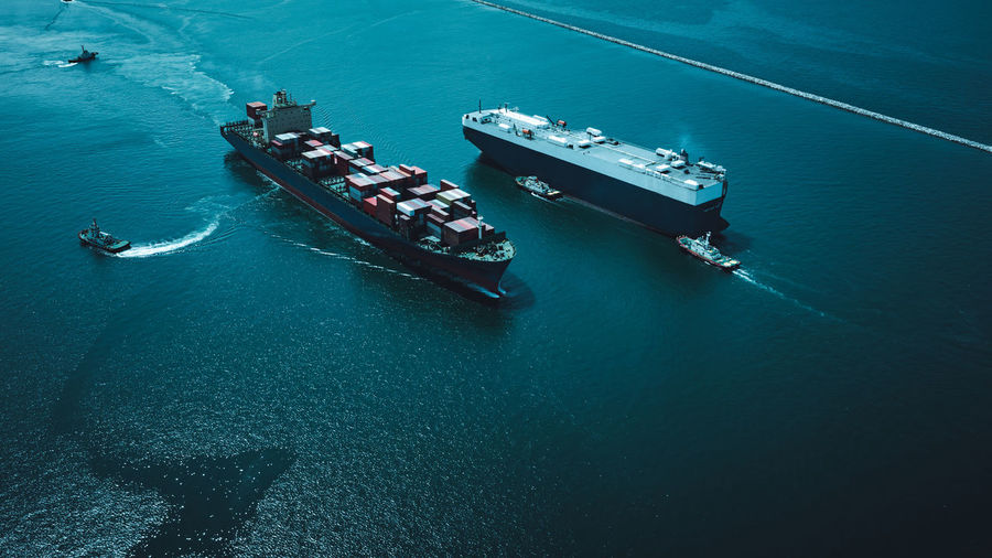 High angle view of shipping container sailing on sea