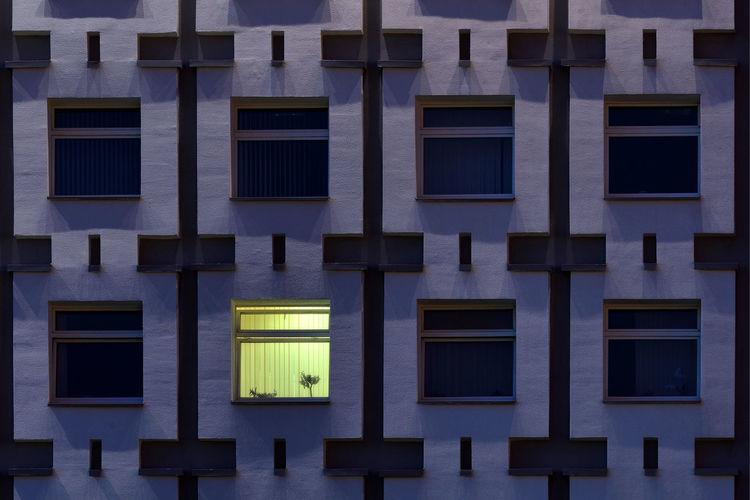 Full Frame Shot Of Residential Building In City At Dusk
