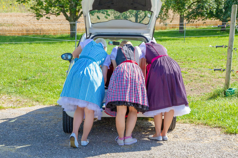 Three girls in dirndl on their car Baden-Württemberg  Bavaria Fashion Fun Funny German Humo Munich München Oktoberfest Travel Car Dirndl Family Females Festival Germany Girls Group Of People Leisure Activity Nature Rear View Sister Tourism Women