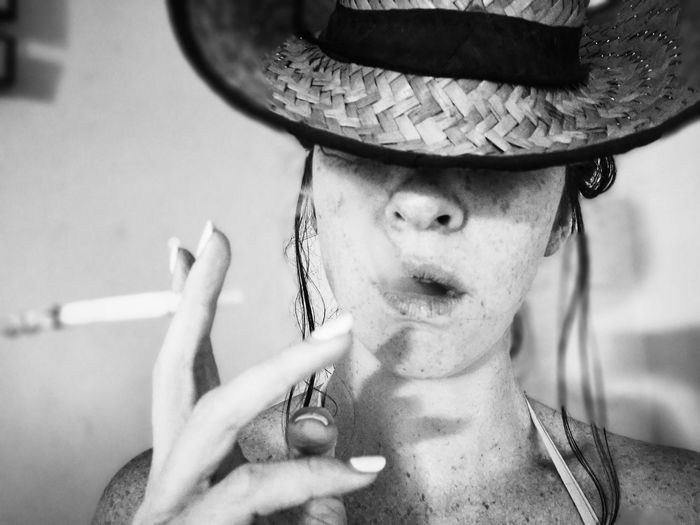 It's Dark Smoker Smoking Cigarette  Black And White Portrait Headshot Looking At Camera Mid Adult Front View Men Hat Close-up Cowboy Hat Wearing Surfer Cropped Posing Thoughtful