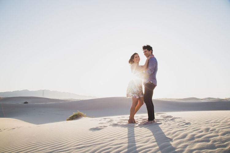 Side view of smiling couple at desert
