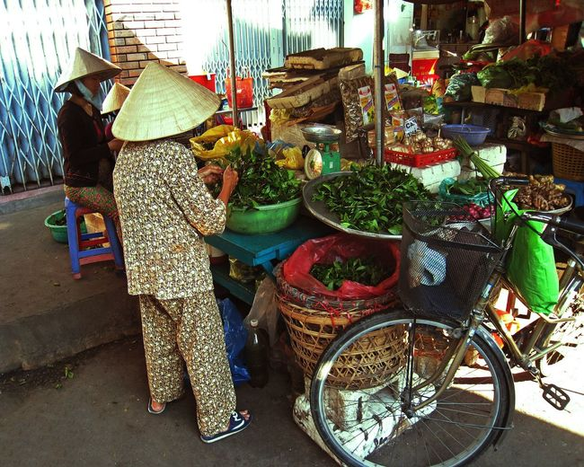 Vietnamese senior lady working at her grocery while wearing traditional conical hat Basket Retail  Small Business Real People Vegetable Market Day One Person Outdoors Food Freshness People Market Old Lady Senior Society Elderly Activity Conical Hat Vietnam Tourisme Attraction Tourist Hojimin City