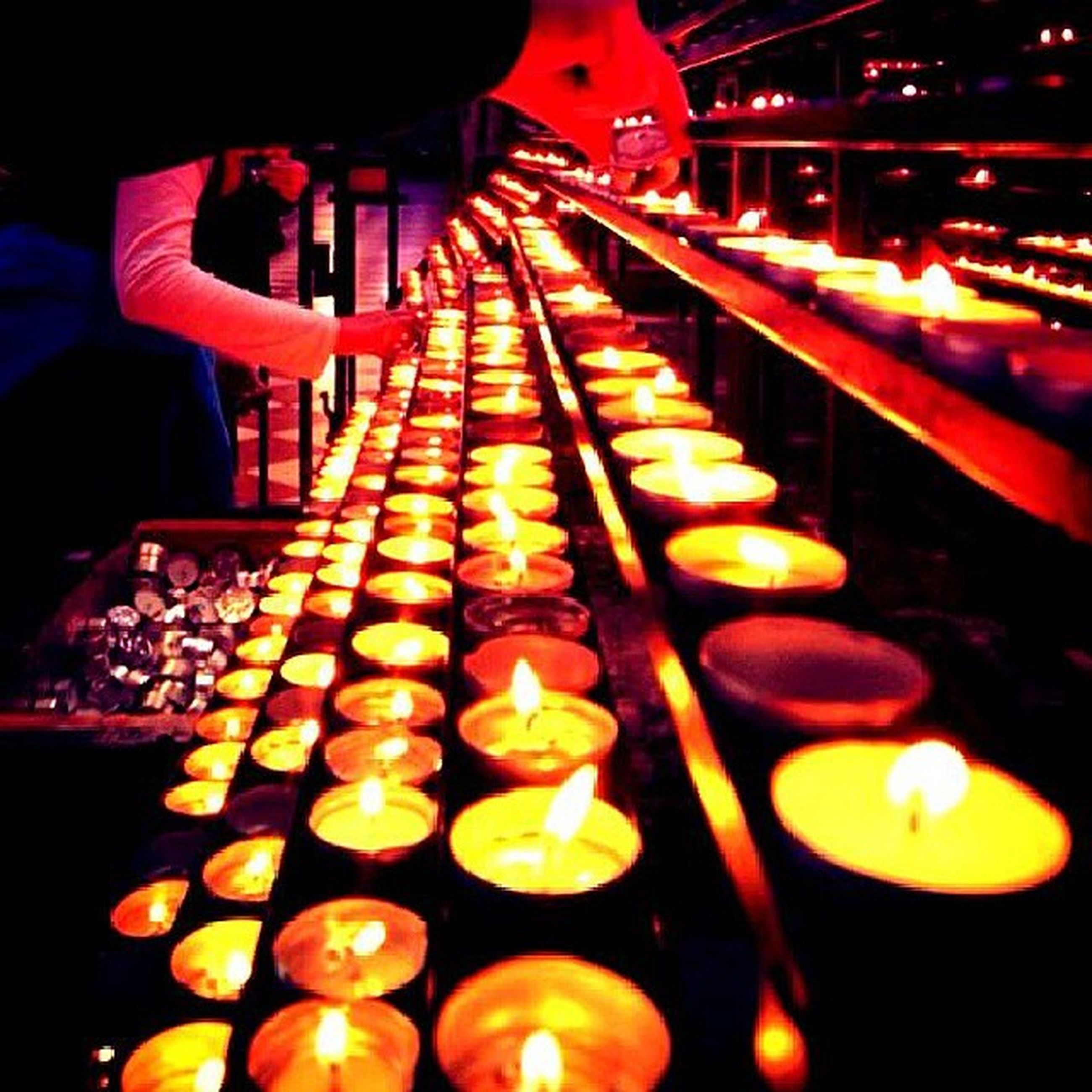 illuminated, night, indoors, burning, flame, fire - natural phenomenon, heat - temperature, glowing, candle, lit, lighting equipment, light - natural phenomenon, in a row, fire, large group of objects, religion, wood - material, tradition, close-up, hanging
