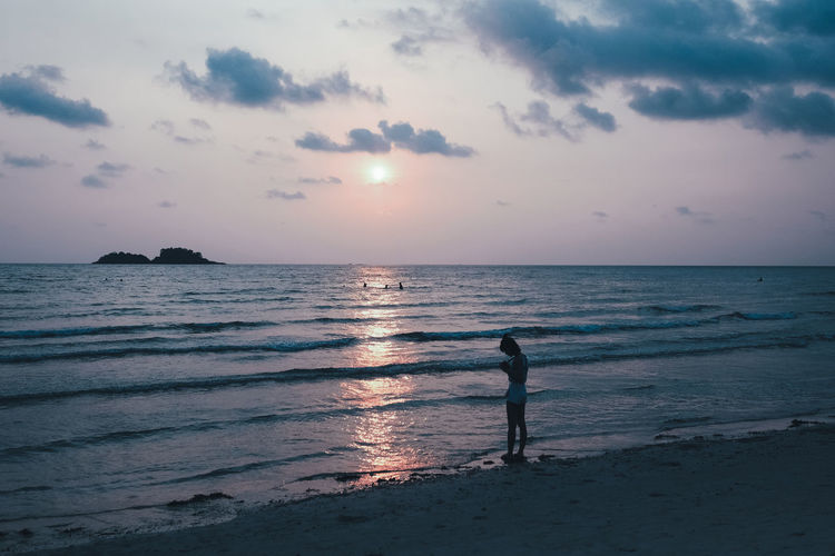 Blue Sea Sky Sea Water Beach Horizon Land Sunset Horizon Over Water Beauty In Nature Scenics - Nature Cloud - Sky Real People Tranquility Leisure Activity One Person Tranquil Scene Lifestyles Nature Silhouette Outdoors It's About The Journey