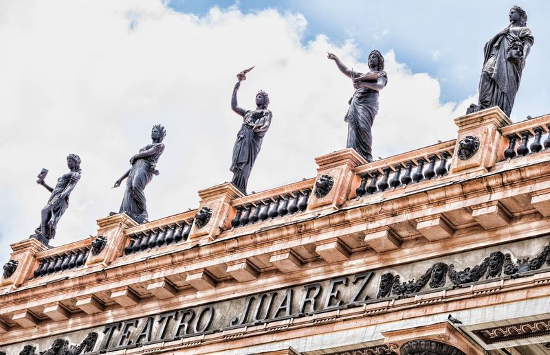 Teatro Juárez Statue Sculpture Art And Craft Human Representation Low Angle View Architecture Creativity Male Likeness Built Structure Cloud - Sky Travel Destinations Outdoors Sky Day Tourism Building Exterior City No People The Graphic City