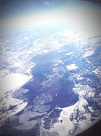 Flying Over Canada From An Airplane Window Snowy Mountains Icy Water Frozen Lake Airborne To America The Places I've Been Today The Traveler - 2015 EyeEm Awards
