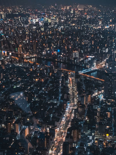 High angle view of illuminated city buildings at night in tokyo japan