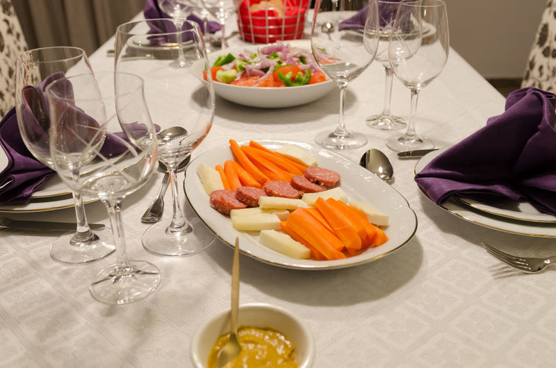 Festive table NapkinFolding Napkins Salad Carrots Cheese Drinking Glass Food Food And Drink Freshness Healthy Eating Indoors  No People Place Setting Plate Ready-to-eat Table Wine Wineglass