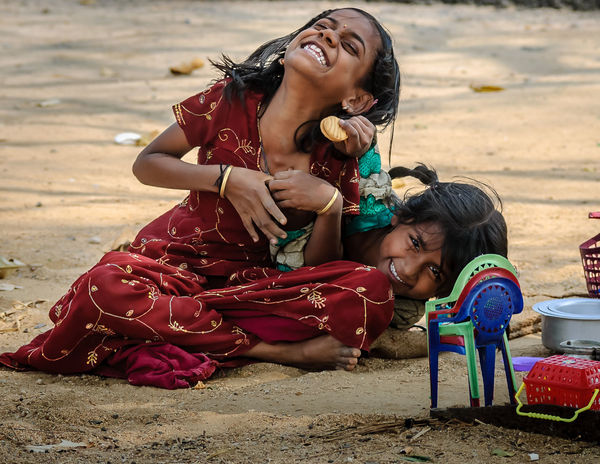 Candid Childhood Cute Day Enjoyment Focus On Foreground Full Length Fun Fun Activity Gunbir Happiness Innocence Leisure Activity Lifestyles Outdoors Person Portrait Relaxation Sitting Teasing Toothy Smile Vacations