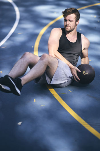 Young Man Exercising On Basketball Court