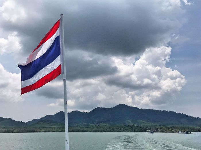 Thailand Cloud - Sky Sky Flag Patriotism Water Mountain Nature Beauty In Nature Mountain Range Day No People Wind Outdoors Scenics - Nature