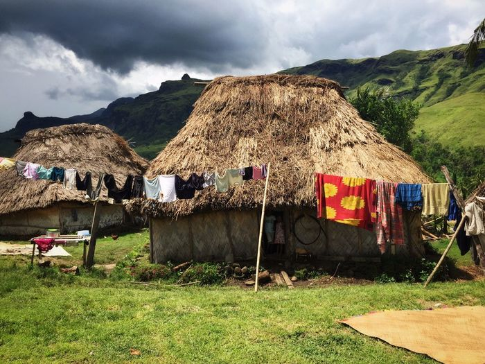 Clothes Drying On Clothesline By Thatched Roof Huts In Village