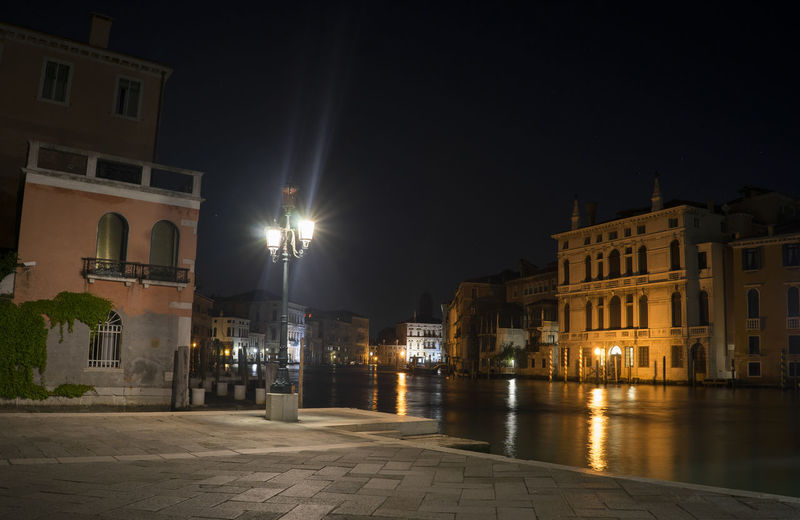 Architecture Building Building Exterior Built Structure City City Life Dark Empty Exterior Façade Glowing Illuminated Lens Flare Night No People Outdoors Residential Building Sky Street Light Venice Canal The Architect - 2016 EyeEm Awards Cities At Night Gran Canal Italy Your Ticket To Europe