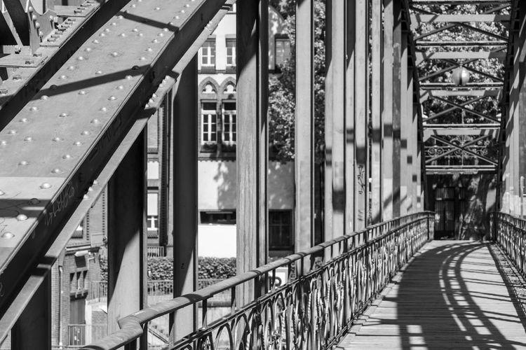 Footbridge amidst buildings