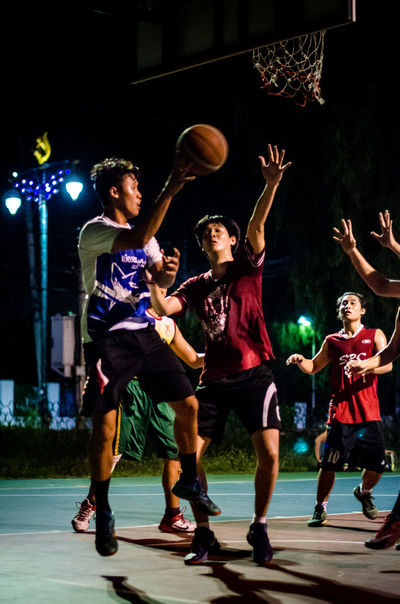 Basketball Action Activity Basketball Basketball Court Basketball ❤ Casual Clothing Chon Buri Group Of People Hoop Jump Leisure Activity Lifestyles Man Men Night Play Player Playinig Shoot Sport Stop Tactics Teenager Thailand