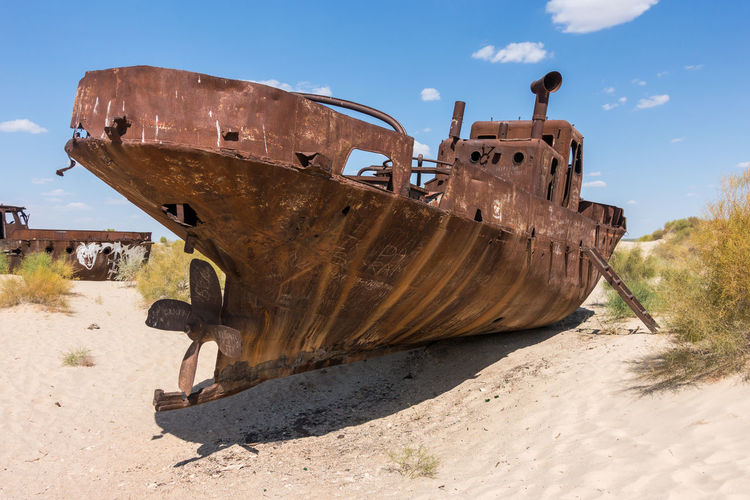 Abandoned ship on the Aral Sea, one of the biggest environmental disaster in the world, Muynak, Uzbekistan Aral Sea Central Asia Karakalpakstan Uzbekistan Abandoned Beach Damaged Day Industry Mode Of Transport Nature Nautical Vessel No People Outdoors Run-down Rusty Sand Sky Sunlight Transportation