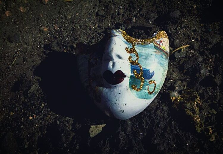 """""""The final resting place of all facades"""" (2016) Porcelain Face Broken Face In The Ditch Dirt Soil On The Ground"""