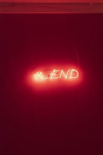Illuminated neon text on wall