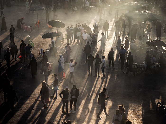Smoky sunsets at the Place Jemaa El Fna in Marrakech EyeEm Best Shots Jemaa El Fnaa Life Marrakech Medina, Morocco Marrakesh Medina Morocco Olympus Silhouette Smoke Sunset Silhouettes Travel Travel Photography Crowd Culture High Angle View Large Group Of People Light And Shadow People Real People Street Street Photography Week On Eyeem The Street Photographer - 2018 EyeEm Awards EyeEmNewHere The Photojournalist - 2018 EyeEm Awards The Traveler - 2018 EyeEm Awards