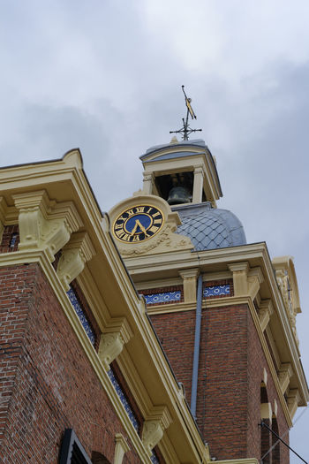 tower of Restaurant 't Havenmantsje in Harlingen, Netherlands Architecture Brick Building Exterior Built Structure Clinker Clock Cloud - Sky Day Gold History Low Angle View Netherlands Netherlands ❤ No People Outdoors Restaurant Sculpture Sky Statue Tower Travel Destinations
