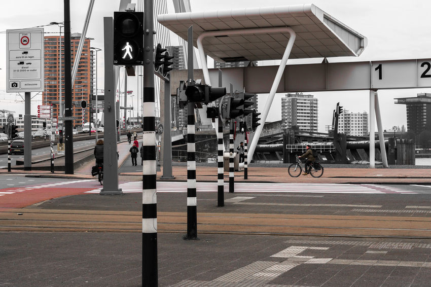 Erasmus Bridge The Architect - 2018 EyeEm Awards Architecture Bicycle Building Exterior Built Structure City City Street Crosswalk Day Land Vehicle Marking Mode Of Transportation Outdoors Road Road Marking Road Sign Sign Stoplight Street Symbol Transportation Zebra Crossing